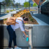 a woman refilling her water bottle at Image of Aquafil Elegrí Premium Drinking Fountain