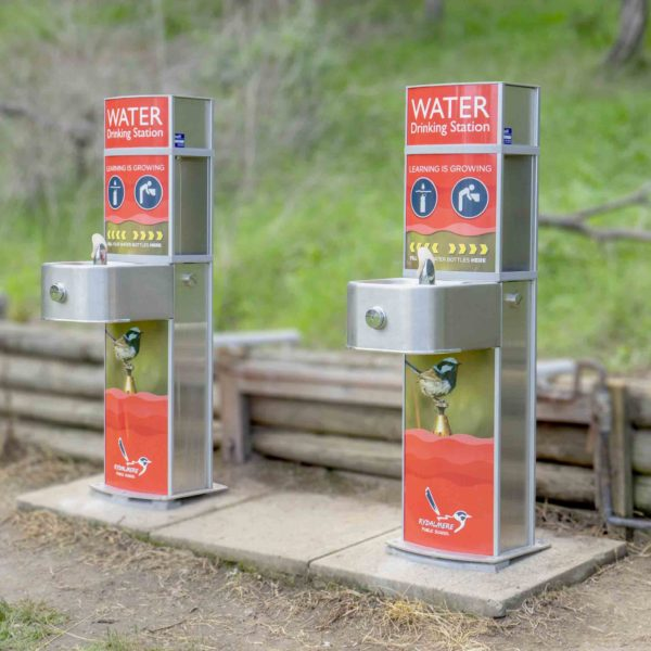 Two Aquafil Pulse Junior Drinking fountain and bottle refill station in orange finished installed at Rydelmere Public School