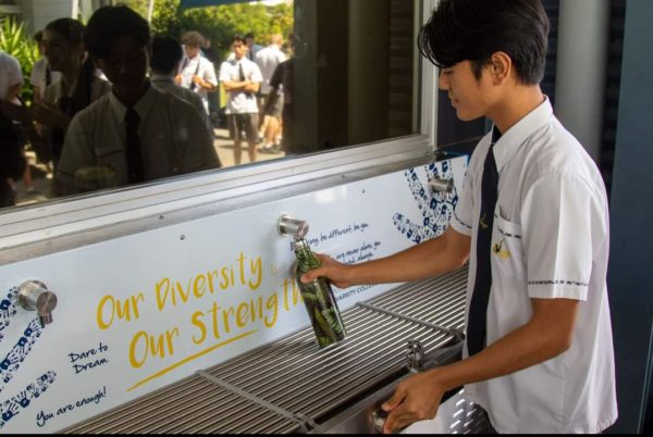 a student refilling his water bottle from CIVIQ Hydrobank School Drinking Trough