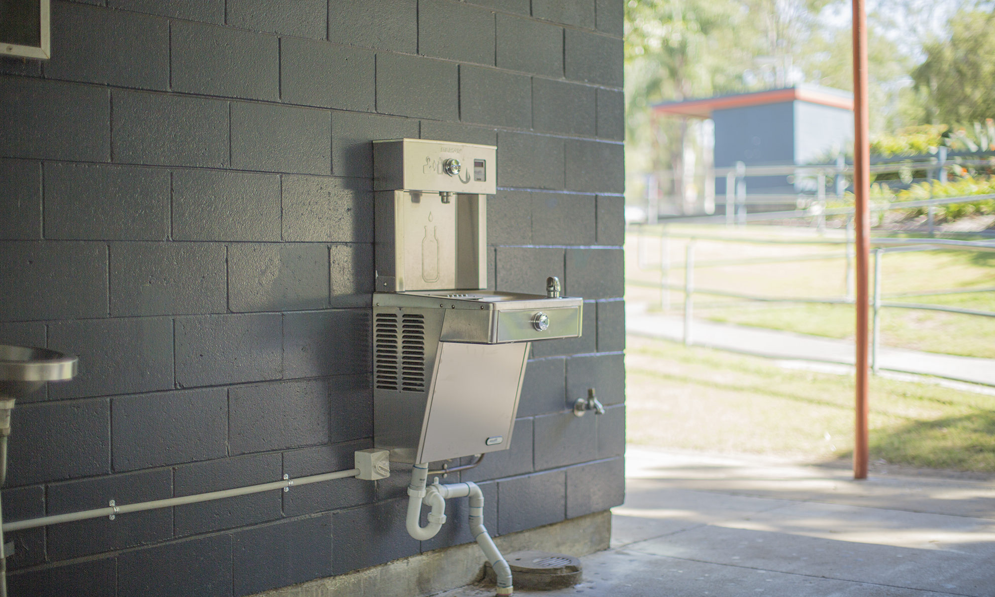 An Elkay EZH2O Vandal-Resistant Drinking Fountain and Bottle Filling Station installed in a School