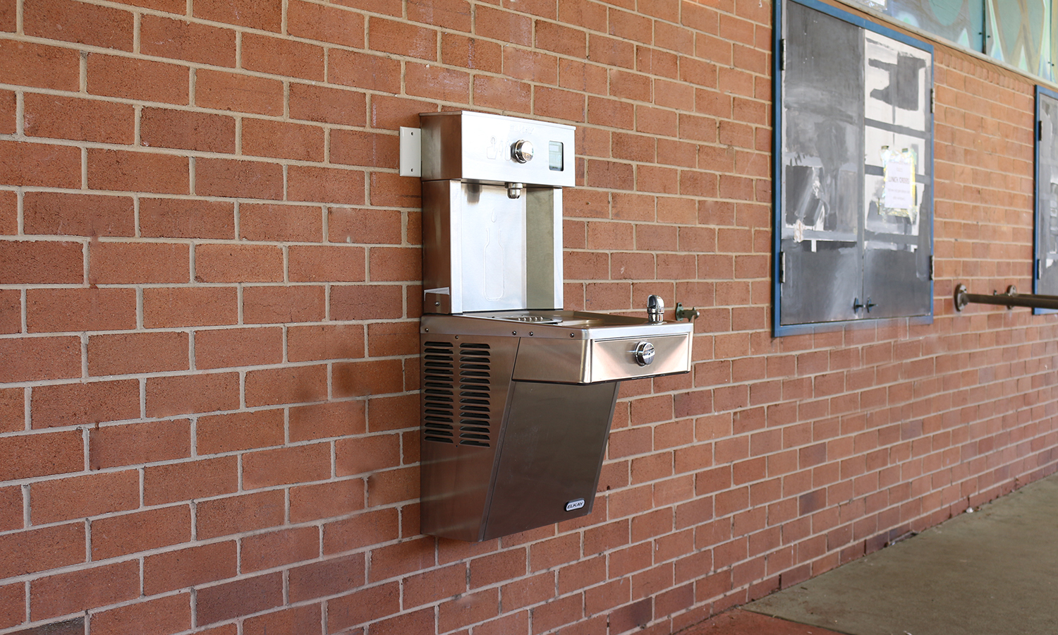 an installed Elkay EZH20 Wall Mounted Drinking Fountain and Water Bottle Filling Station