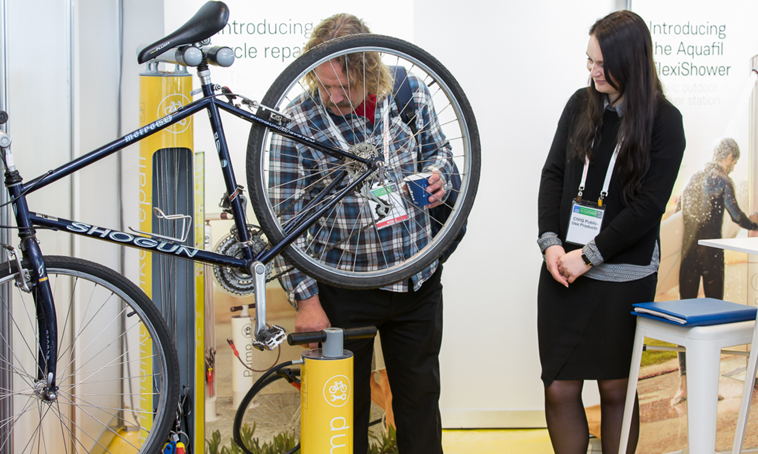a Visitor of Parks and Leisure Australia event inspecting CIVIQ's bike repair products