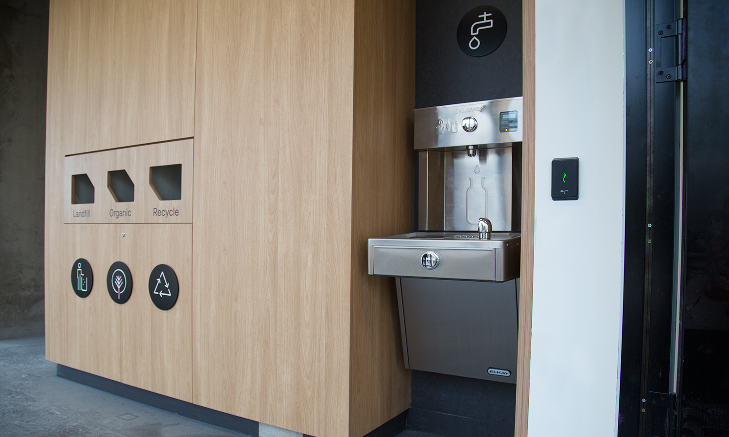 Drinking fountain station positioned next to smart recycle facility