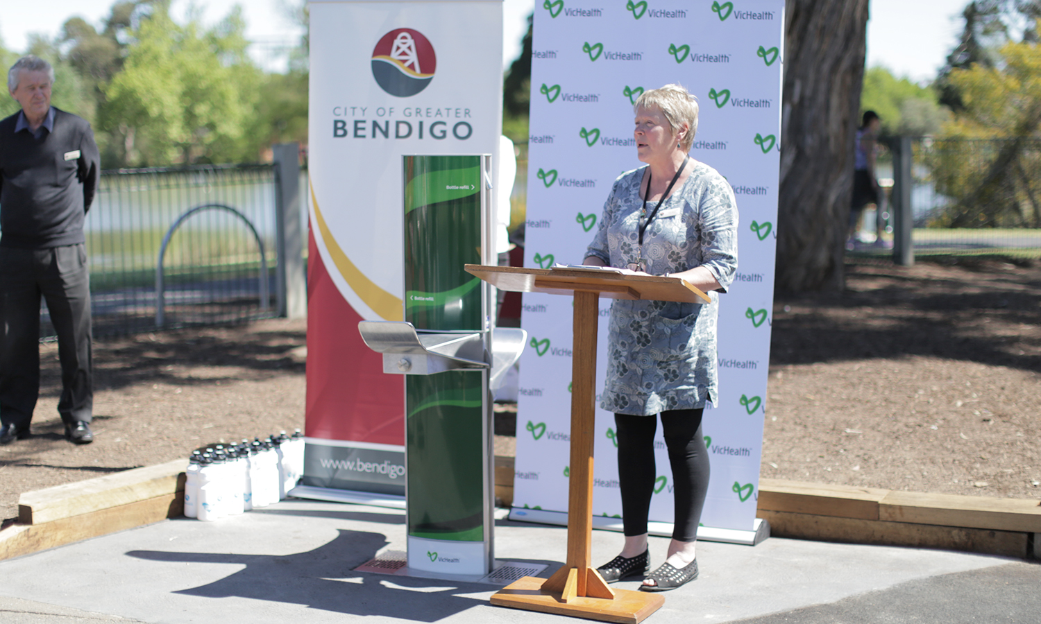 Maree Edwards giving speech on Greater Bendigo Community beside next to Aquafil FlexiFountain 1500BFF Drinking Fountain and Water bottle refill station