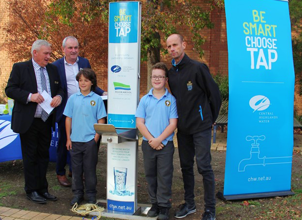 Moorabool Shire Council with two young school boys from St Brigid's Primary School Taking Picture between CIVIQ Drinking Fountain