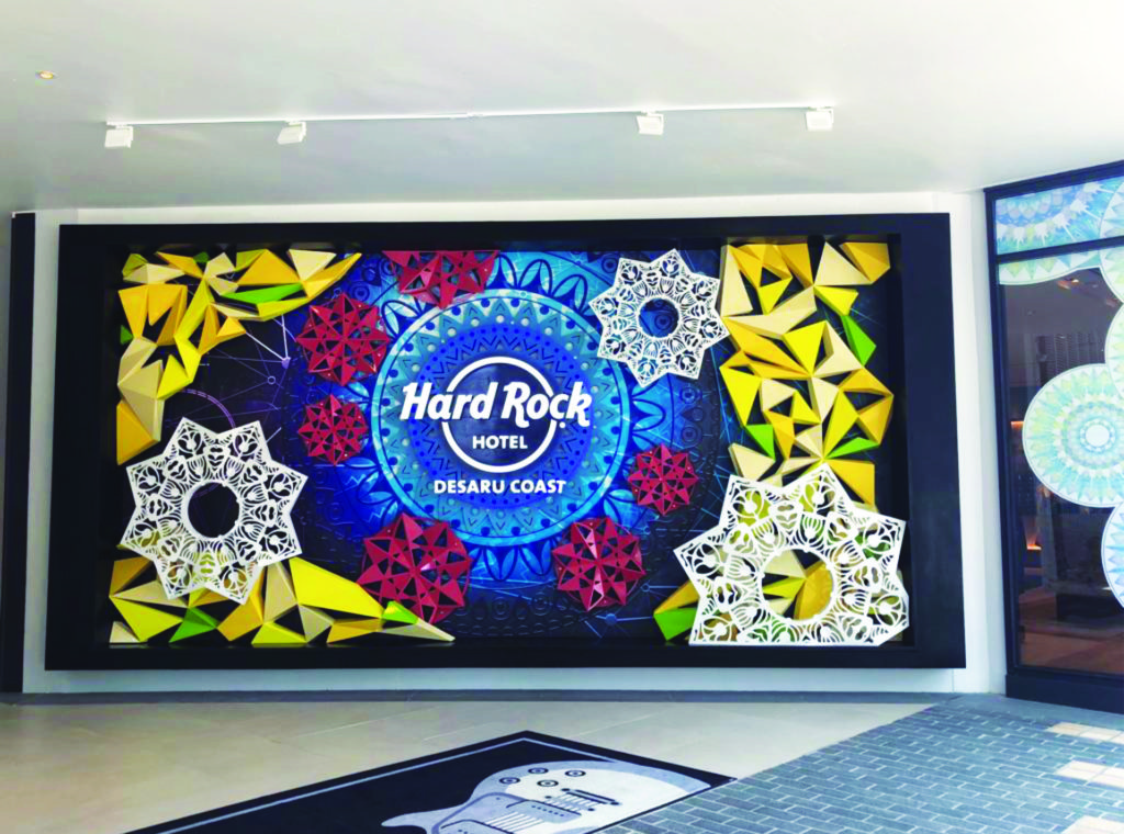 An art design with a Hard Rock Hotel Desaru Coast caption placed on the entrance of the hotel