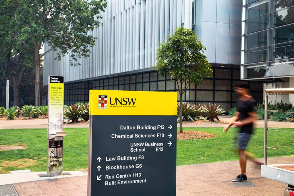 A drinking water fountain along with wayfinding signage in UNSW Sydney Dalton Building