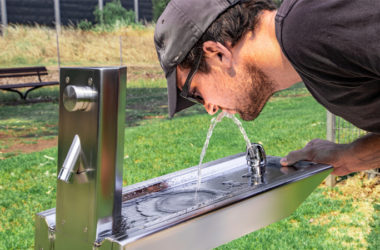 A man drinking through Aquafil Bold Drinking Water Fountain from CIVIQ
