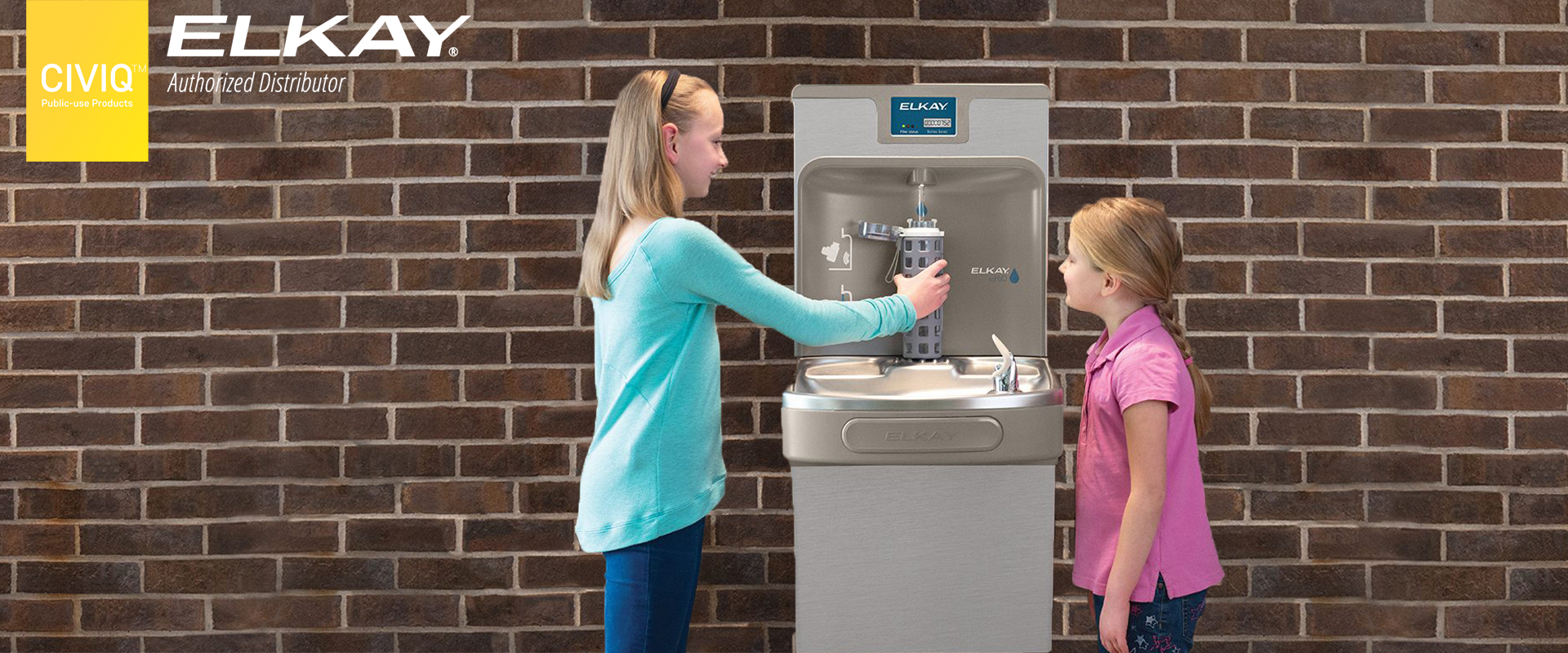 two girls refilling their water bottles at EZH2O Drinking Fountains