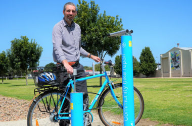 Aaron Izzard, Mount Gambier Environmental Sustainability Officer standing beside Cycla Fixit Maintenance and Repair Station