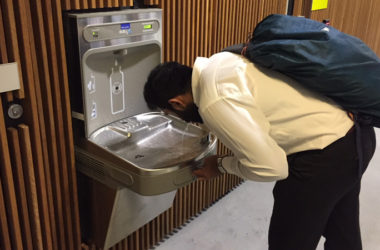 Staff of UTS enjoying himself drinking on a Elkay EZH2O Drinking Fountain