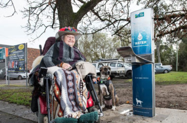 Michelle Mc Donald in a wheelchair standing beside of the new Aquafil Drinking Water Fountain in Lilydale