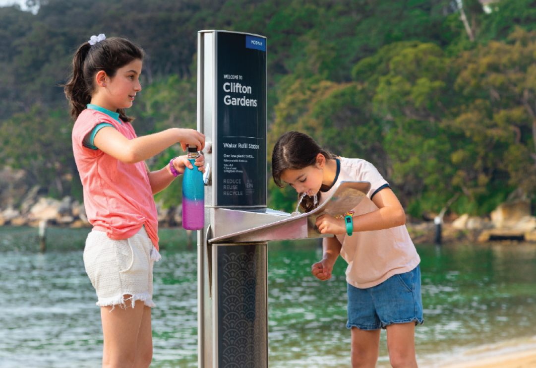 little girls at the beach using a water dispenser product from CIVIQ